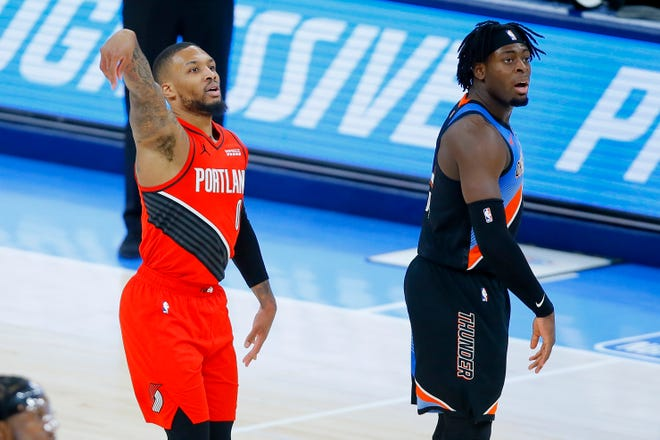 Portland's Damian Lillard watches as he makes a 3-pointer against Lu Dort and the Thunder.