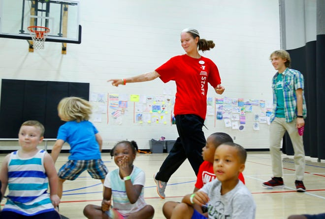 Summer camps are planned throughout the metro area this year. Seen here are children participating in a group game during a previous year's summer camp activity at the Midwest City YMCA.