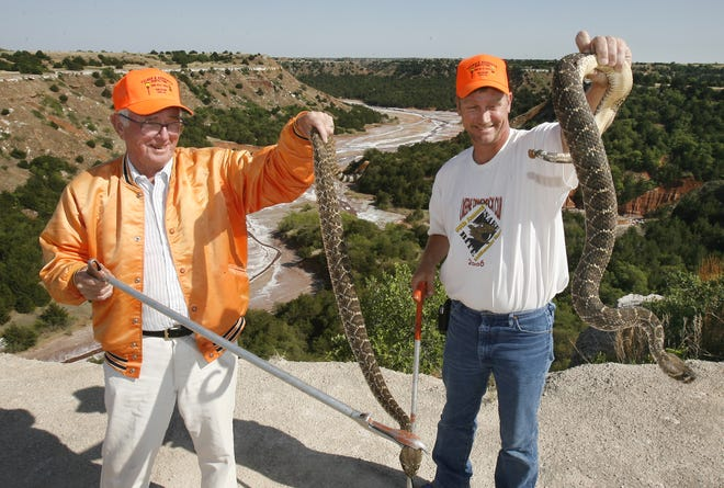 In this 2006 photo,  Anthony Felder and his son, Tony Felder, catch rattlesnakes in the Salt Creek Canyon near Roman Nose State Park for the Okeene Rattlesnake Roundup. Tony Felder died from a snake bite five years ago.