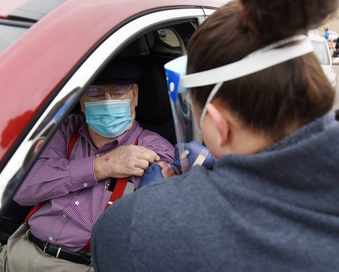 Vaccinations are being administered at a drive-thru at the Oklahoma City Indian Clinic.