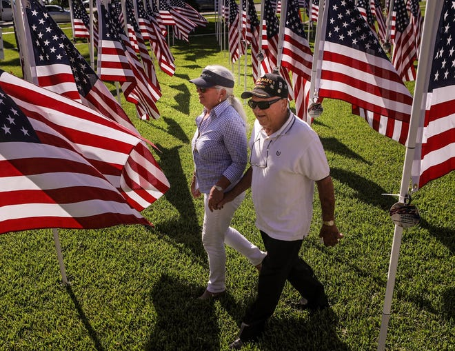 Joan Sargent and her dad, 98-year-old World War II Veteran Bill Nacinovich, walk through a field of flags during the inaugural Flags for Heroes charity event at Bradley Park in November 2019. The event returns this fall after being postponed last year because of the coronavirus pandemic.