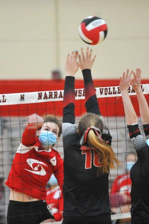 Block Island's Amira Wilson tries to spike the ball over a pair of Narragansett players during the first set of Friday's match.