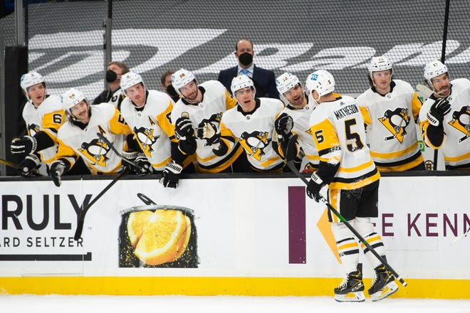 Apr 1, 2021; Boston, Massachusetts, USA; Pittsburgh Penguins defenseman Mike Matheson (5) celebrates with teammates after scoring a goal against the Boston Bruins in the second period at TD Garden. Mandatory Credit: Kathryn Riley-USA TODAY Sports