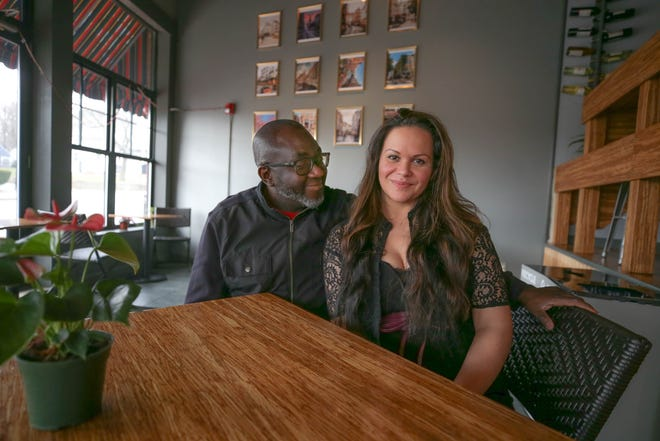 Natacha Legein with her husband and business partner, Anthony Adagboyi, at the Crepe Corner in Cranston. She's battling back after life-threatening injuries.