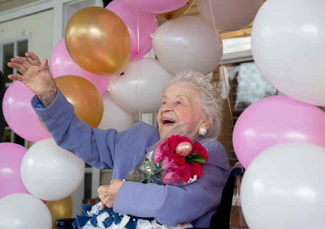 Leona Mezga, who turned 102 on April 3, celebrated her birthday on April 1 at Gardens at Liberty Park with a parade, cupcakes and the Easter Bunny. Leona waves to the parade of senior service providers wishes her a happy birthday.