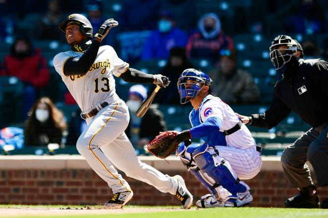 Pittsburgh Pirates' Ke'Bryan Hayes (13) watches his two-run home run during the first inning of a baseball game against the Chicago Cubs Thursday, April 1, 2021, on opening day at Wrigley Field in Chicago.