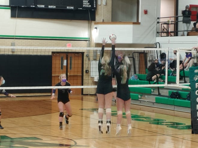 Rock Falls scores an early point with a block in its 25-22, 25-18 girls volleyball win over Rockford Lutheran on Thursday that gave the Rockets sole possession of first place in the Big Northern Conference.