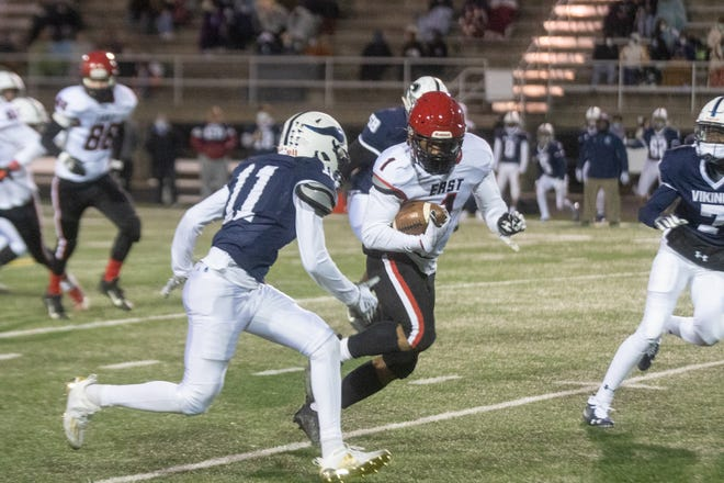 East running back CJ Berry breaks free against Guilford  at Guilford High School on Thursday in Rockford.