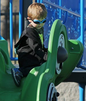 Christopher Kennedy, 5, plays on one of the playground activities while exploring Olivia's Playground, 323 Center St., for the first time in Salina. The park opened in 2019 and is specially designed to provide fun for all children, including children with disabilities.