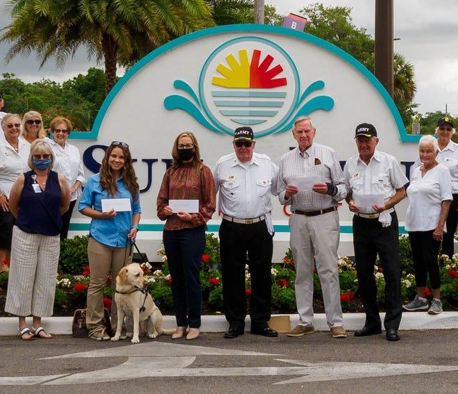 Recipients of donations from the Sun N Fun RV Resort Honor Guard include Katie McCoy, Renee Snyder, Robert Graham and Ken Williston.