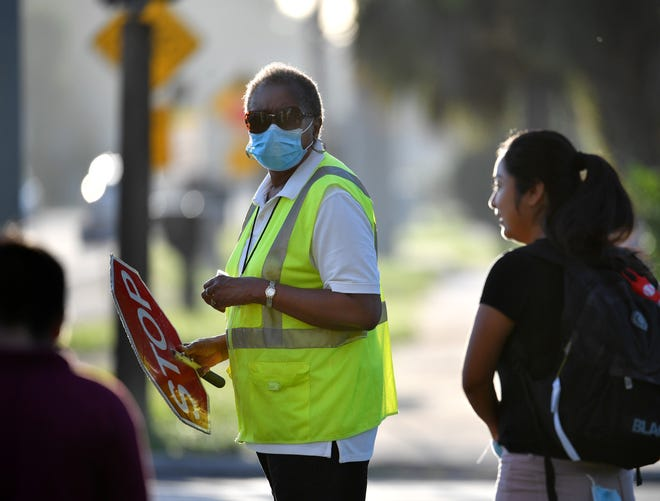 Crossing guard Deborah Reaves helps make sure students and parents get to school safely on Aug. 31, 2020, at Wilkinson Elementary. Reaves has been a crossing guard at Beneva and Wilkinson roads for seven years.