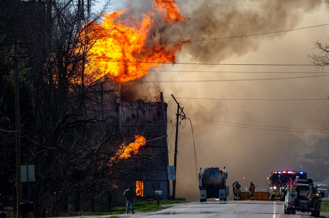 A water tanker from the Pleasant Plains Fire Department arrives to assist firefighters as they battle a massive blaze that has fully engulfed the feed store next to the Bradfordton Co-Op Association grain elevator In the 4400 block of West Jefferson Street in Springfield, Ill., Friday, April 2, 2021. [Justin L. Fowler/The State Journal-Register]