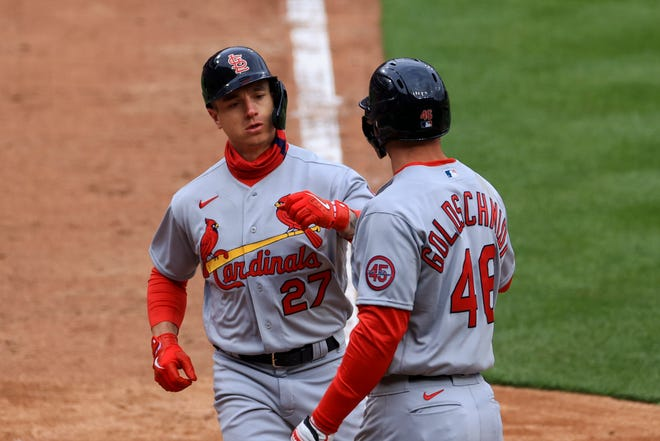 St. Louis Cardinals' Tyler O'Neill, left, celebrates hitting a two-run home run with teammate Paul Goldschmidt during the fourth inning of the baseball game against the Cincinnati Reds in Cincinnati, Thursday, April 1, 2021.