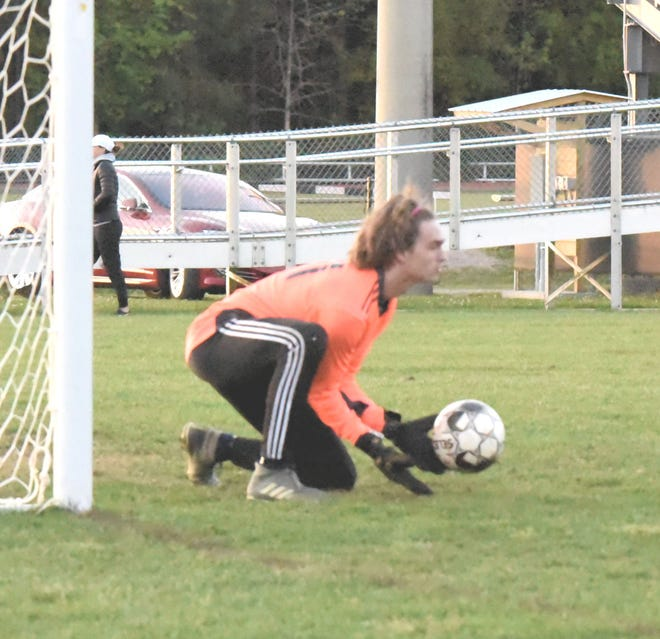Effingham County freshman goalkeeper Ethan Smart stops a penalty kick by Richmond Hill late in the first half. The Wildcats won in overtime 3-2 on Thursday.