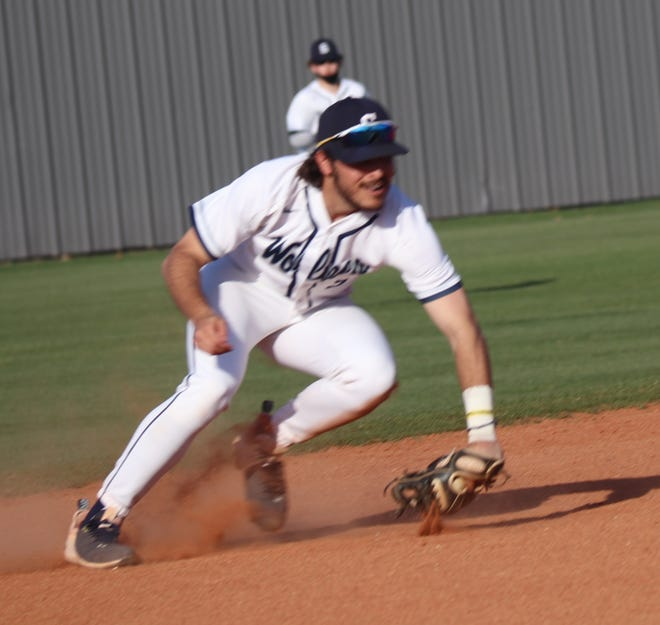 Shawnee shortstop Krew Taylor makes a nice fielding play to his right against Southmoore Thursday night. Taylor fielded the ball cleanly but the throw was not in time as the SaberCats picked up the infield hit.