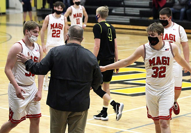 Colon seniors exit the floor from their regional finals appearance with Webberville on Thursday. Both Ian Eells and Grayson Riethmiller share a moment with coach Steve Vinson.