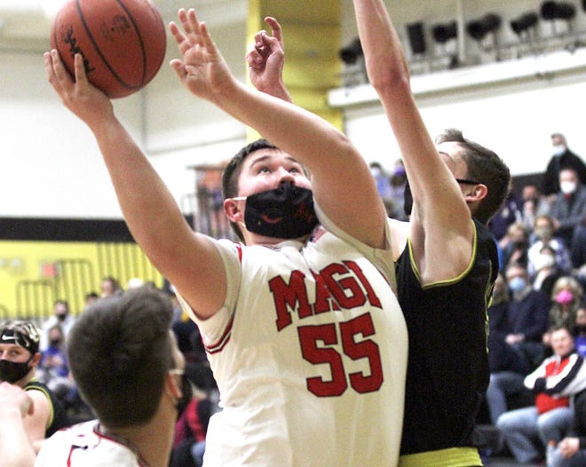 Colon's Mason Paliga muscles his way up to score two points against Webberville on Thursday.