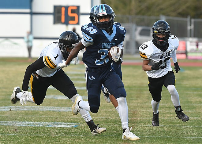 Hoggard's Sam Williams goes in for a touchdown against Topsail in April when the Vikings clinched the Mideastern Conference championship. Can they repeat this fall? [KEN BLEVINS/STARNEWS]