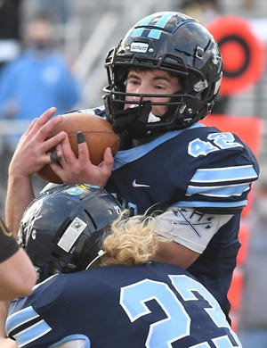 Hoggard's #42 Isaiah Shelton comes down with a second interception as Hoggard took on Topsail Thursday April 1, 2021 at Scott Braswell Stadium in Wilmington. Hoggard clinched a share of MEC title with a 38-7 win over Topsail.  [KEN BLEVINS/STARNEWS]