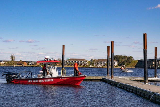Rescue boats return to Lawson Creek Park following a day of searching for a missing Vanceboro man.