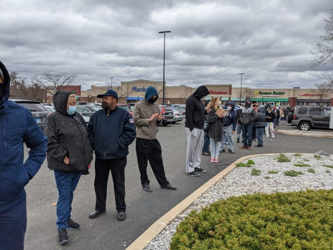 Hartford residents line up for COVID-19 vaccinations Thursday, the first day of eligibility for anyone 16 or older. The pop-up clinic in a shopping center parking lot inoculated 260 people with the one-shot Johnson & Johnson vaccine.