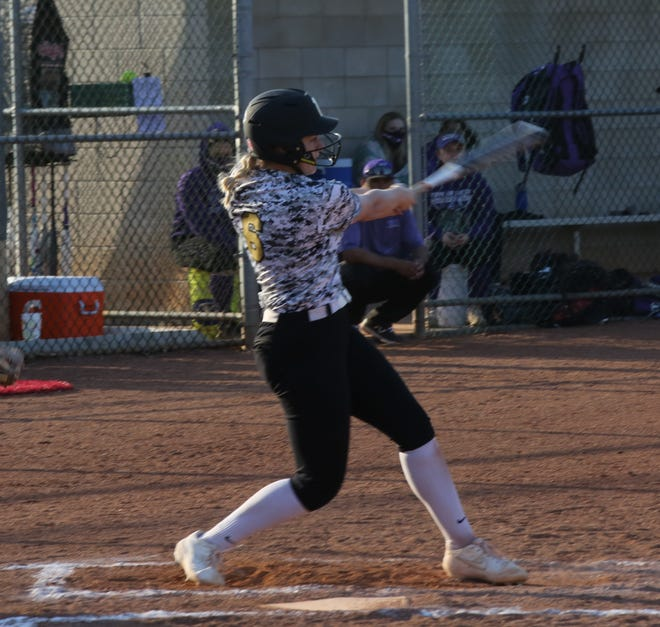 Topeka High senior Zoe Caryl smashes a three-run home run during a 12-run second inning in the Trojans' 19-3 win over Topeka West in the second game of Thursday's doubleheader at Hummer Sports Park. Caryl drove in seven runs in the game and 11 in a sweep of the Chargers.