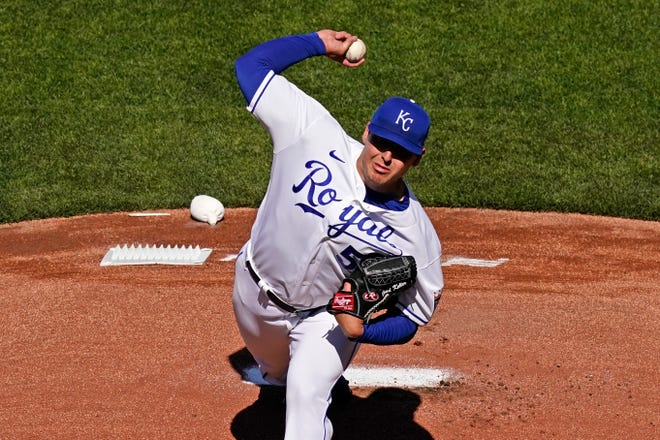 Kansas City Royals starting pitcher Brad Keller throws during the first inning of the team's baseball game against the Texas Rangers on Thursday, April 1, 2021, in Kansas City, Mo. (AP Photo/Charlie Riedel)