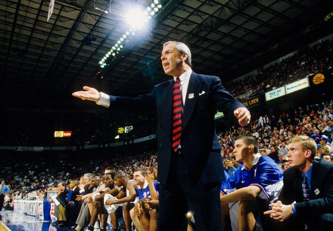 Roy Williams, who retired Thursday, won three national championships and compiled a 903-264 career record across 33 seasons at Kansas and North Carolina. Williams went 418-101 in his 15 seasons with the Jayhawks (1989-2003).