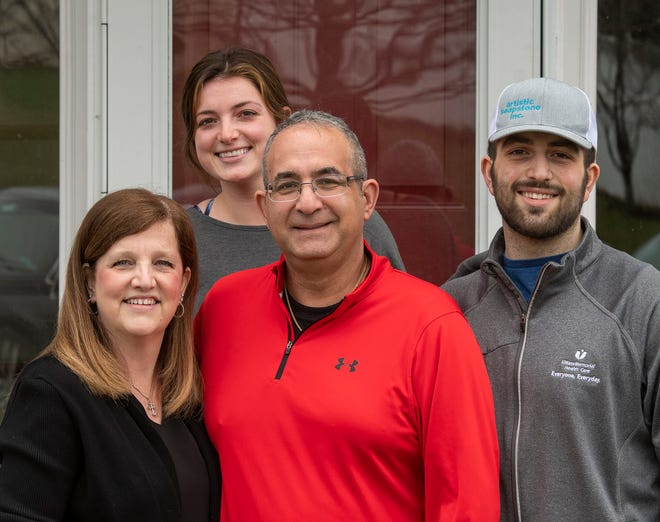 David Sarkisian is photographed at his Auburn home with wife, Darlene, daughter Emily, and son Brian Thursday.