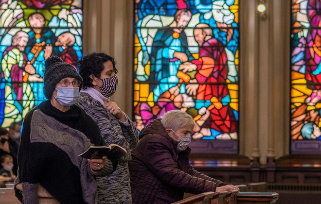 Catholic worshippers listen to Scripture of Jesus Christ's crucifixion during Good Friday services at the Cathedral of Saint Paul on Friday in Worcester.