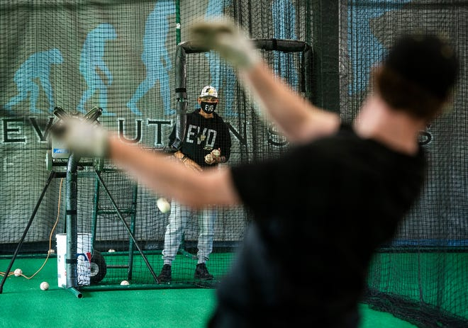 Phil Price works with Wachusett's Travis Moran at Evolution Baseball Facility on Tuesday, March 30, 2021.