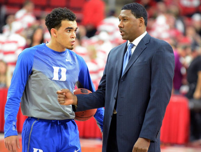 Jan 11, 2015; Raleigh, NC, USA; Duke Blue Devils guard Tyus Jones (left) talks to assistant coach Nate James (right) prior to a game against the North Carolina State Wolfpack at PNC Arena. Mandatory Credit: Rob Kinnan-USA TODAY Sports