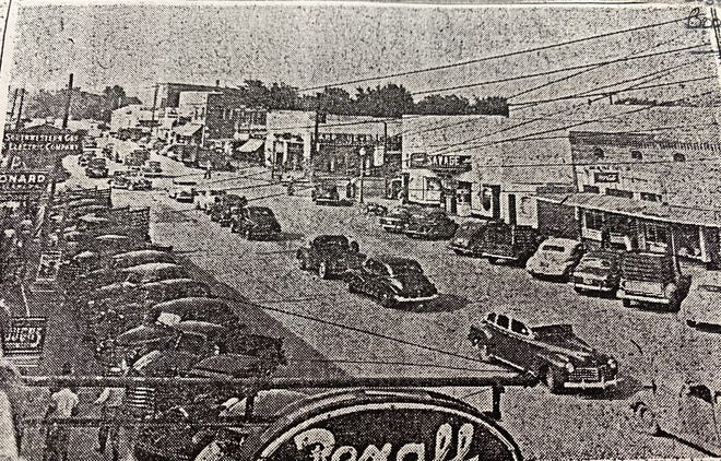 A historical photo shows the Savage Theater on North Broadway Avenue in Booneville.