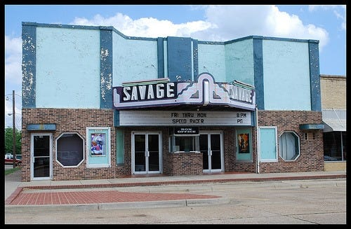A historical photograph shows the Savage Theater as it once was. Rod and Mandy Lovan bought the theater in December 2020 and hope to bring it back to its former glory as an operational movie theater.