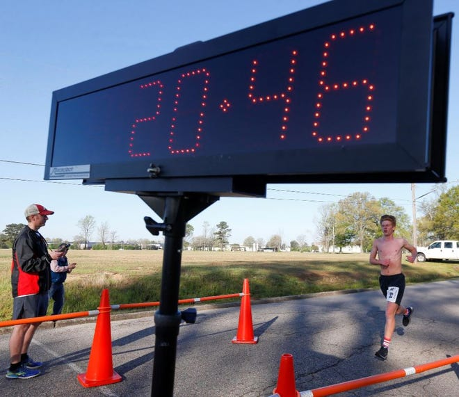Pictured is a clock used to track runners' times during a 5K race in March 2018.