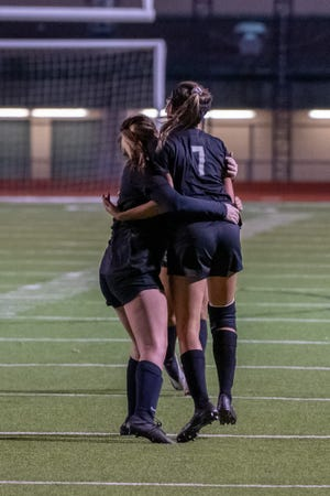 Waxahachie's Kaydence Ramirez (7) and two teammates celebrate during a home soccer game earlier this year. The Lady Indians beat Mesquite Horn on Tuesday, 1-0, in the area round of the Class 6A Region II playoffs at Mesquite Memorial Stadium.