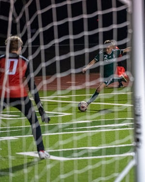 Waxahachie senior Luke Villarreal (2) takes aim at the net during a recent home boys' soccer game. The Indians' season came to an end in a 2-0 area-round playoff loss to Rockwall-Heath on Tuesday night at Forester Field in Dallas.