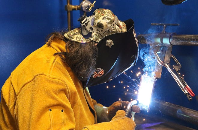 Sophomore William Mendez, 16, of Lancaster, worked on gas metal arc welding in Metal Fabrication and Joining Technology class at Minuteman Tech, April 1.