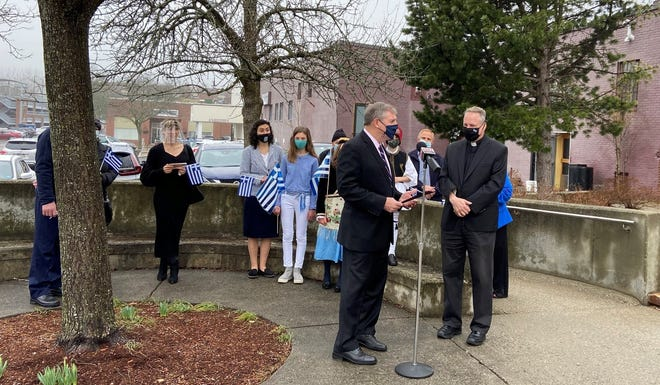 Greek Independence Day was recognized on March 25 as Marlborough Mayor Arthur  Vigeant presented a proclamation to Father Gregory Nicholas Christakos and parishioners from Sts. Anargyroi Greek Orthodox Church in Marlborough. The presentation was made on the terrace behind the Marlborough City Hall.