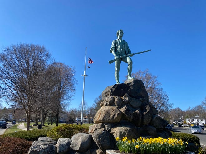 The Lexington Minuteman statue stands at the town green of Lexington, Massachusetts.