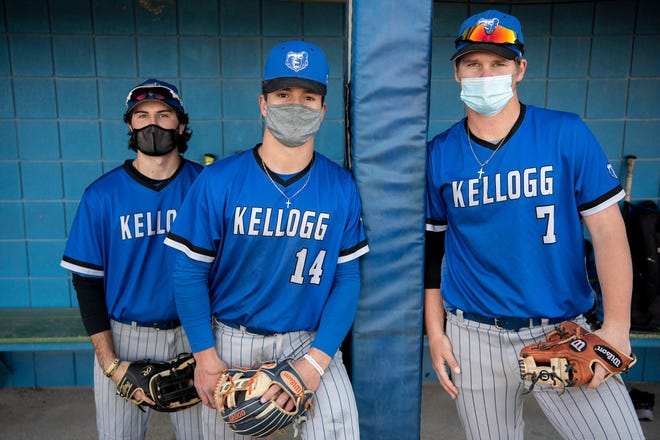 Kellogg Community College sophomore Connor Brawley, freshman Justin Ratliff and freshman Jayden Dentler stand in the dugout on Friday, April 2, 2021 at Bailey Park in Battle Creek, Mich.
