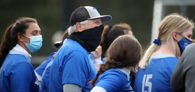 Olympic head coach Chuck Stark talks with his team in between innings during their game against Central Kitsap on Thursday, April 1, 2021.