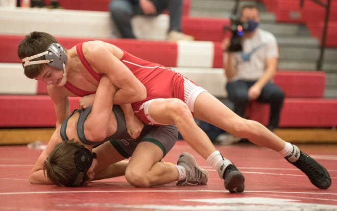 Paulsboro's Logan Sichelstiel, top, controls West Deptford's Anthony Catando during the 106 lb. bout of the wrestling meet held at Paulsboro High School on Friday, April 2, 2021.  Sichelstiel defeated Catando by pin.