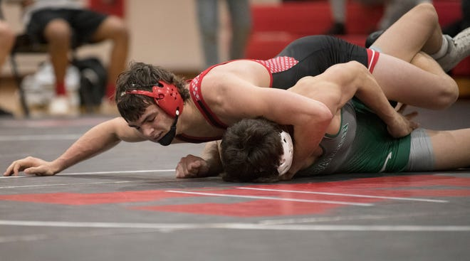 Kingsway's Dakota Morris controls Delbarton's Louis Cerchio during the 160 lb. bout of the wrestling meet held at Kingsway Regional High School on Thursday, April 1, 2021.  Morris defeated Cerchio, 6-2.
