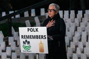 Helen Eddy, director of the Polk County Health Department speaks to honor the 589 residents of Polk County who were lost to COVID-19 on April 1, 2021 at the Polk County Administration Building in Des Moines.