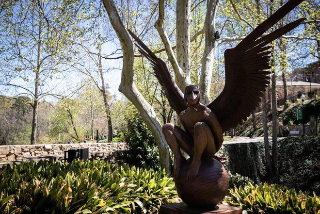One of the sculptures that is part of the Wings of the City traveling art exhibit at Falls Park Friday, April 2, 2021. The exhibit was created by Mexican artist Jorge Marin and was originally exhibited in his home country before being exhibited in Texas, Colorado and California, beginning in 2013. Greenville is the first city on the east coast to to host the exhibition. The sculptures will remain until October.