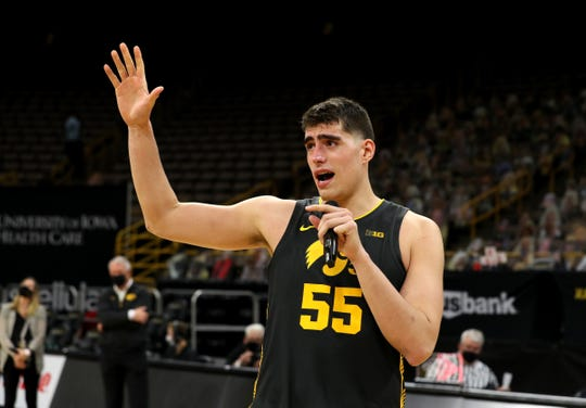 Iowa center Luka Garza reacts after learning his No. 55 jersey would be retired following the Hawkeyes' March 7 home win against Wisconsin.