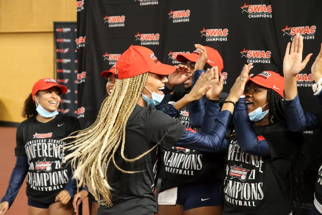 Members of the Jackson State women's volleyball team celebrate winning the spring 2021 Southwestern Athletic Conference Volleyball Tournament Championship.