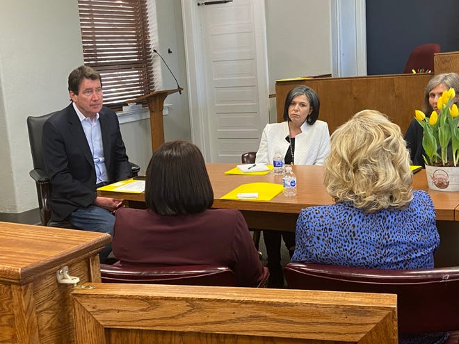 Tennessee Senator Bill Hagerty listens to Judge Christy Little and other children's advocates from Madison County.