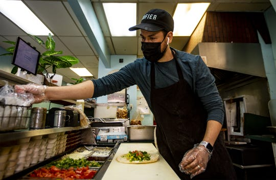 Chef and owner Youness El Mesyah prepares a chicken shawarma wrap at Safier Mediterranean Deli, located at 641 S. 4th St. in downtown Louisville, Ky. El Mesyah cooks for local mosques during the Muslim holy month of Ramadan. April 2, 2021.